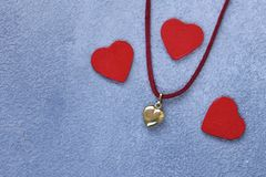 Gold heart pendant. Gift for Valentine`s Day royalty free stock image