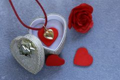 Gold heart pendant. Gift for Valentine`s Day royalty free stock images