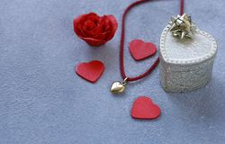 Gold heart pendant gift. For Valentine`s Day royalty free stock photos