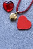Gold heart pendant. Gift for Valentine`s Day stock photography