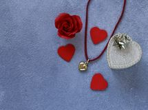 Gold heart pendant. Gift for Valentine`s Day royalty free stock photography