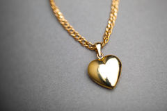 Gold heart pendant Stock Photos
