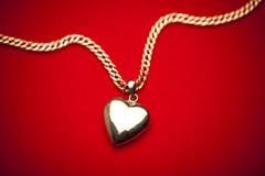 Gold heart pendant Royalty Free Stock Photos