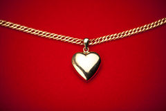 Gold heart pendant Stock Photography