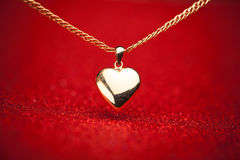 Gold heart pendant Royalty Free Stock Image