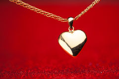 Gold heart pendant Stock Image