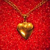 Gold heart pendant Stock Photos