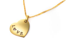 Gold heart pendant Valentines Day. Gold heart pendant jewel isolated on white stock images