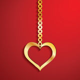 Gold heart pendulum isolate Stock Images