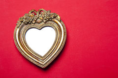 Gold Heart Picture Frame On Red Royalty Free Stock Images