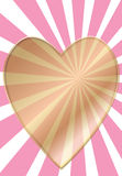 Gold heart with pink rays Stock Photo