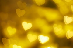 Gold heart shape bokeh background. Floating Gold heart shape bokeh background Royalty Free Stock Photography