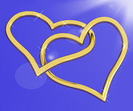 Gold Heart Shaped Rings On Blue Royalty Free Stock Photo