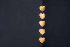 Gold heart stickers on dark background with blank space Royalty Free Stock Image