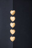 Gold heart stickers on dark texture background Royalty Free Stock Photography