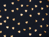Gold heart stickers on dark textured background Stock Photo