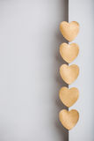 Gold heart stickers on grey textured background Royalty Free Stock Photo