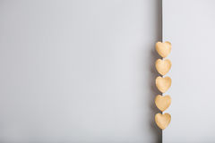 Gold heart stickers on grey textured background Stock Image