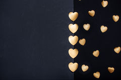Gold heart stickers over dark textured background Royalty Free Stock Image