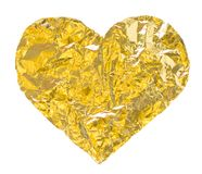 Gold heart. Gold textured heart, abstract symbol stock image