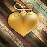 Gold heart on wooden background.  + EPS10 Royalty Free Stock Photos