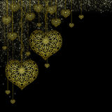Gold hearts on a black background Stock Image