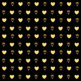 Gold hearts confetti seamless pattern on a black background. Gold glittering foil hearts seamless pattern on a black background. Luxury Elegant Happy Valentine Royalty Free Stock Image
