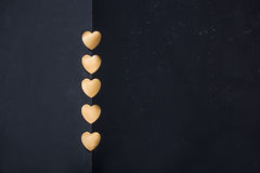 Gold hearts on dark background Stock Photo