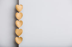 Gold hearts on grey background Stock Photography
