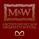 Gold hearts patterned letters with couple initial monogram Stock Image
