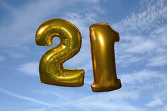 Gold helium filled 21st birthday balloons Stock Photos