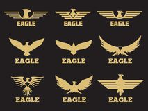 Gold heraldic eagles logo collection on black background Royalty Free Stock Photography