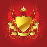 Gold heraldry shield Royalty Free Stock Photos
