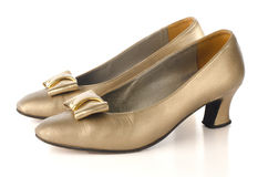 Gold high-heeled shoes Royalty Free Stock Photos