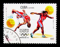 Gold, high jumps, women's discus, Olympic Games 1992 - Barcelona royalty free stock photo