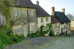 Gold Hill, Shaftesbury. Gold Hill is a hill and a famous street in Shaftesbury in the English county of Dorset. It is a steep cobbled street featured on the Stock Photos