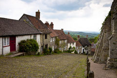 Gold Hill Shaftesbury UK. View of old cottages on a steep hill in a rural setting Royalty Free Stock Photo