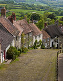 Gold Hill Shaftesbury UK. View of old cottages on a steep hill in a rural setting Stock Images