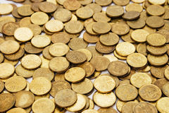 Gold hoard wealth. Gold coins on the table evenly. background texture stock image