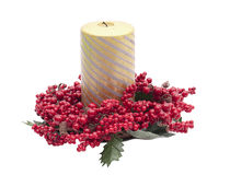 Gold holiday candle with red berries Royalty Free Stock Photography