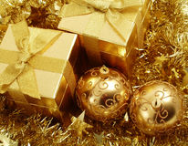 Gold holiday gifts and decoration Stock Photography