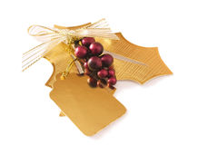 Gold holly gift tag Royalty Free Stock Photo