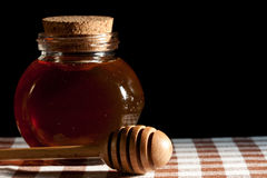 Gold honey and dipper Royalty Free Stock Photos