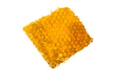 Gold honeycomb. On the white background Stock Images