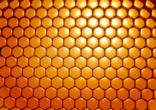 Gold honeycombs. Abstract background in the form of three-dimensional model of honeycombs Royalty Free Stock Image