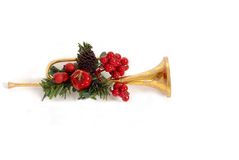 Gold horn Christmas Ornament with holly. Isolated on white Royalty Free Stock Photos