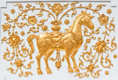 The gold horse. Fairy tale horse in Thai art on white background,Chiangrai province Thailand Royalty Free Stock Image