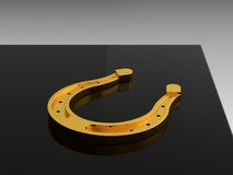 Gold horseshoe Royalty Free Stock Image