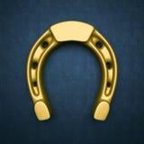 Gold  horseshoe on blue background Royalty Free Stock Photography