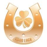 Gold horseshoe and gold trefoil clover. Horseshoe fortunately for good luck Royalty Free Stock Image